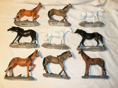 Nine polystone horses assorted colors 4 inches long 4 inches high 1 inch wide