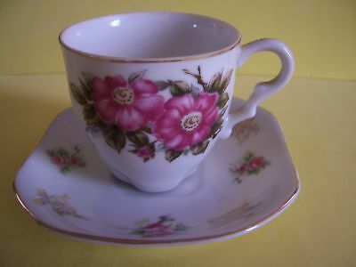 ANTIQUE CUP AND SAUCER SET