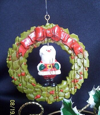 Hallmark Ornament 1976 Twirl About Santa in wreath $V90.00