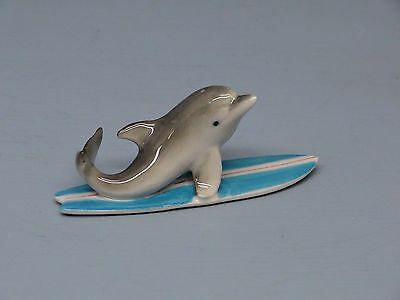 Retired Northern Rose Dolphin Nose Up on Surfboard