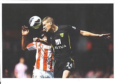 A 12 x 8 inch photo personally signed by Ryan Bennett of  Norwich City