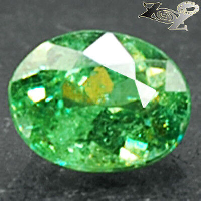Firely Natural Oval 5*6.5 mm. Red Spark Intense Green Andradite Demantoid 1 CT.
