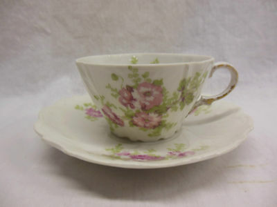 3 LIMOGES CUPS AND SAUCERS WITH PINK FLOWERS                               m2