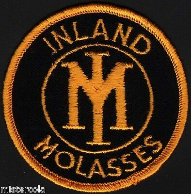 Vintage uniform patch INLAND MOLASSES round unused new old stock n-mint+ cond