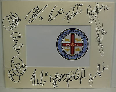 10 x 8 inch mount personally signed by 12 of the Melbourne City 2014-15 squad
