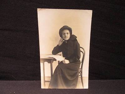 Young Seated Woman in Salvation Army Uniform with hat Early 1900s B&W Postcard