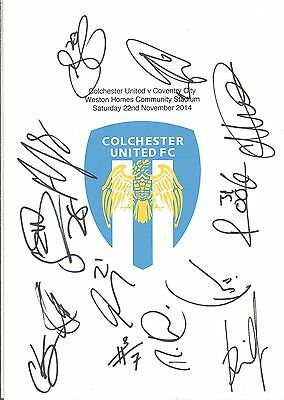 An A4 white card with the Colchester United Badge. Signed by 12 on 22.11.14.