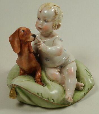 Capodimonte Superb Baby & Dachshund Dog On A Cushion Figure by Giuseppe Cappe