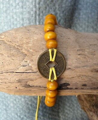 Good Luck Feng Shui Yellow Beaded Bracelet with Fortune Chinese Coin