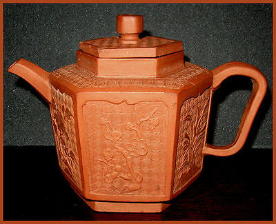 ANTIQUE CHINESE YIXING REDWARE TEAPOT WITH MOULDED PANELS CIRCA 1675 - 1700