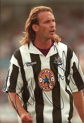 A 12 x 8 inch photo featuring Darren Peacock at Newcastle United, signed by him.