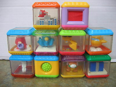 Lot 10 FISHER PRICE PEEK A BLOCK Digger Helicopter Ringmaster Octopus Texture +