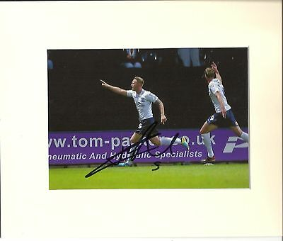 A 10 x 8 inch mount, personally signed by Tom Clarke of Preston North End.