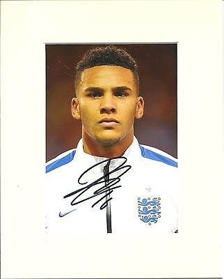 A 10 x 8 inch mount, personally signed by Jaamal Lascelles of England.