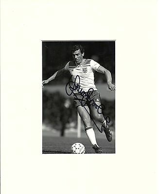 A 10 x 8 inch mount, personally signed by England player Sir Trevor Brooking.
