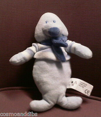Soft Blue Seal Toy Wearing Striped Jmper And Scarf