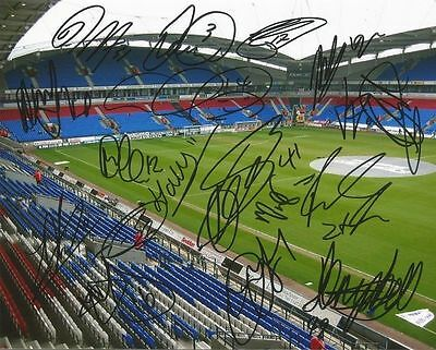 A 10 x 8 inch photo personally signed by 18 of the Bolton Wanderers squad.