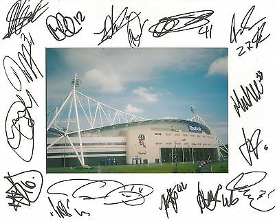 A 10 x 8 inch mount personally signed by 16 members of Bolton Wanderers squad.