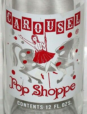 Vintage soda pop bottle CAROUSEL POP SHOPPE girl on horse pictured Warren Ohio