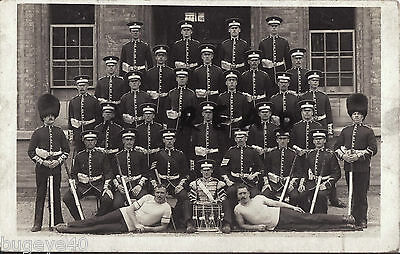 Soldier Squad Group Coldstream Guards in full dress some wear bearskins