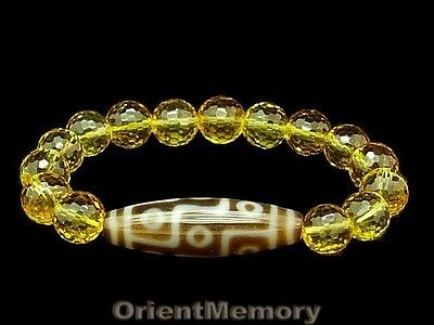 9 Eyes Dzi Bead with 10mm Faceted Citrine Bracelet - Energy Cure