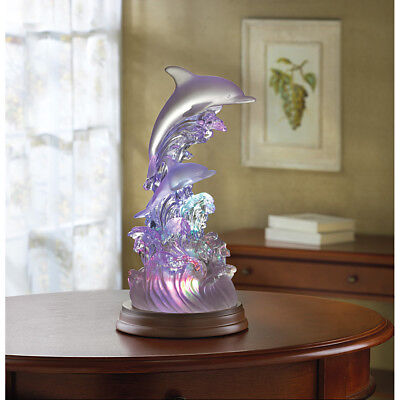 """dolphins On Waves Of Light"" Color Changing Sculpture"