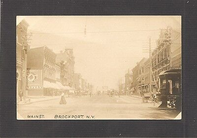 REAL-PHOTO POSTCARD:  MAIN STREET - BROCKPORT, NEW YORK - c.1910 - HORSES, Etc.
