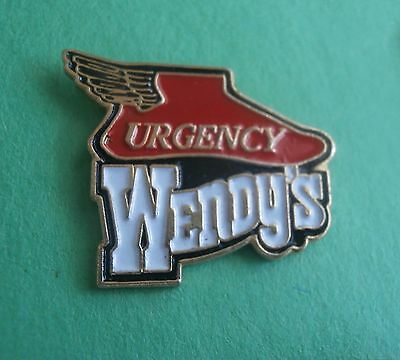 Wendy's Urgency (Shoe with Wings) Lapel Pin
