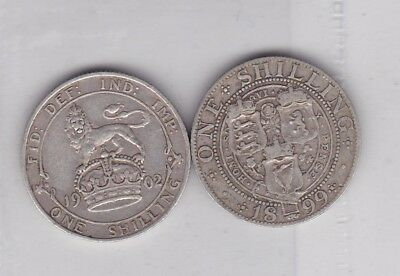 1899 & 1902 Silver Shillings In A Used Good Fine Condition