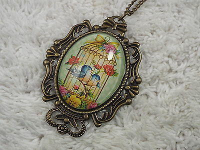 Brasstone Glass Dome Blue Bird Cage Cameo Pendant Necklace  (D56)