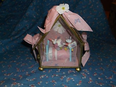 """Cute Crafted Bunnies in Bed Glass House Display About 5 1/4"""" High Pink Backgroun"""