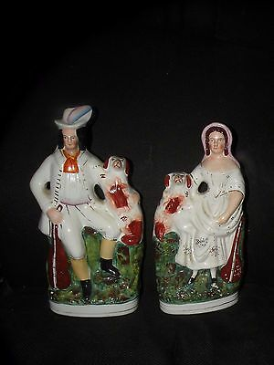 PAIR ANTIQUE STAFFORDSHIRE FIGURES MUSICIANS WITH SPANIELS left and right