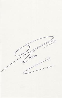A 14 cm x 9 cm white card. Personally signed by footballer Alessio Tacchinardi.