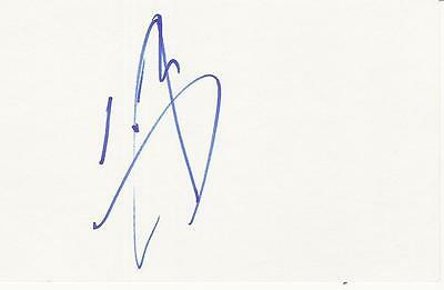 A 14 cm x 9 cm white card. Personally signed by footballer Manu Sarabia.