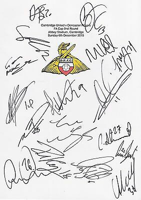 An A4 white card with the Doncaster Rovers Badge. Signed by 17 players on 06.12