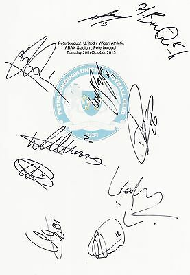 2 A4 white cards with the Peterborough Badge. Signed by 25 players on 20.10.2015