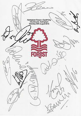 An A4 white card with the Nottingham Forest Badge. Signed by 16 players on 29.08