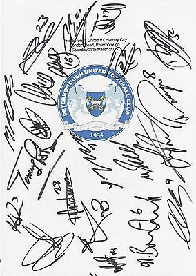 An A4 white card with the Peterborough United Badge. Signed by 21 players.