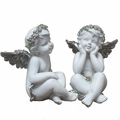 CHERUB sitting & smiling with glittered silver wings - set of 2 ornaments
