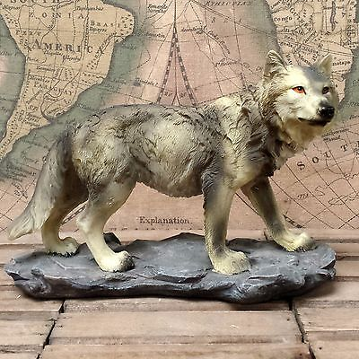 Wolf standing on the rock - ornament, figurine