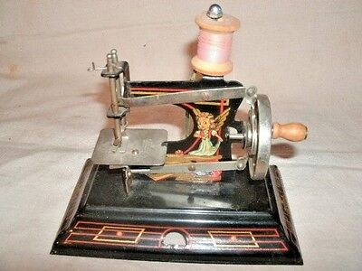 Antique TOY SEWING MACHINE.  Nursery Rhyme Figures.  Casige Brand.  Made in Germ