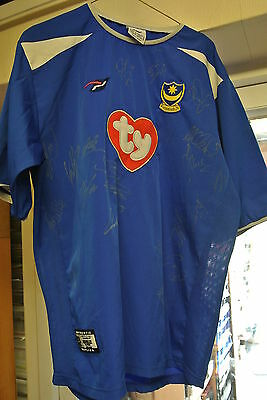 A Portsmouth FC. Shirt signed by 19 players on 29.10.2016 at Cambridge United