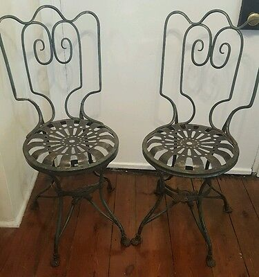 Pair of 19 century French Wrought iron garden chairs by Arras, claw foot