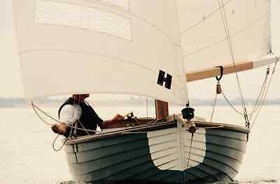 Clinker built wooden sailing boat, gaff rigged classic yacht, wooden dinghy