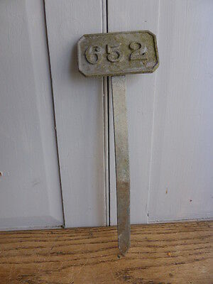 Antique metal garden plant marker number 652