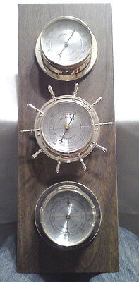 Springfield Thermometer Barometer & Humidity Plastic Gauges on a Wood Background