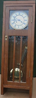 Unusual Looking Large Old Wooden Wall Clock With Glass Panels To Front Door