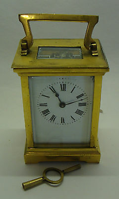 Antique brass cased enamel dial carriage clock