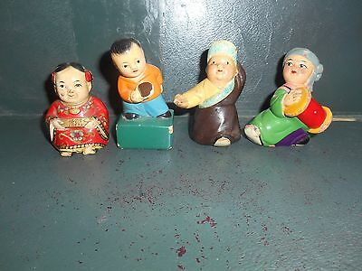 """group of four vintage""""Chinese National Dress"""" ceramic pencil sharpeners)"""