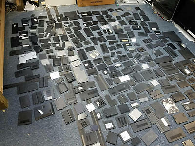 Mixed Lot of Laptop Bottom Covers 294 total  sold AS-IS - 17.6 lbs Great Buy!